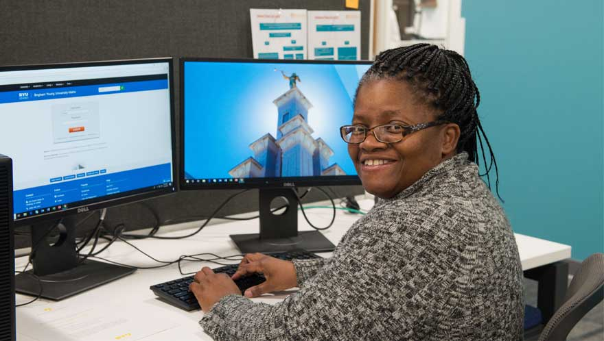 woman smiling working at computer